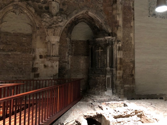 This looks like an entrance into the old church that was later walled up