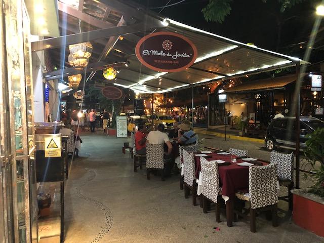 El Mole de Jovita - mole restaurant, photo of the restaurnt sign over the sidewalk and outdoor seating