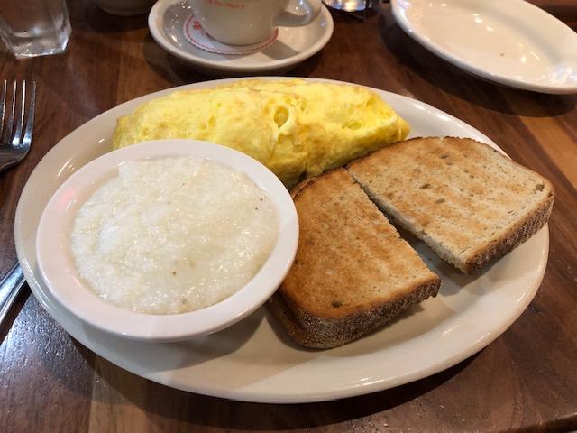 Omelette, grits, rye toast