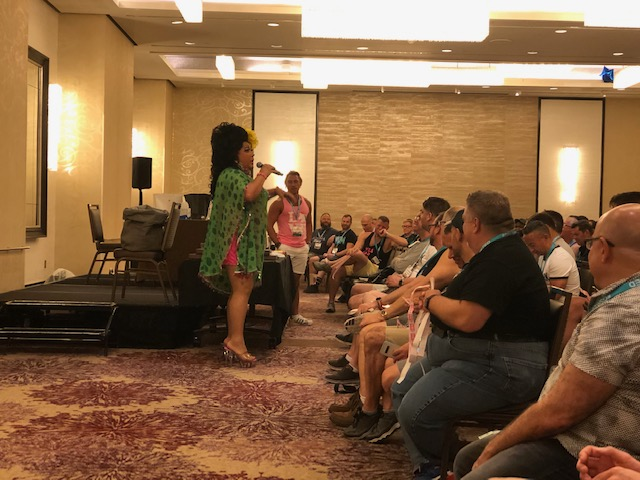 Drag Queen Kay Sedia leading the Raffle