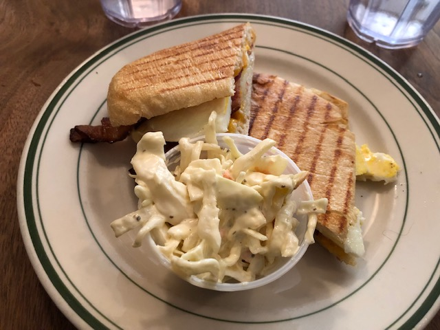 A sandwich and cole slaw