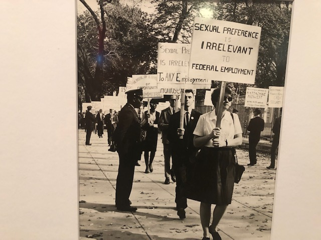 "Photo from the 60s: conservatively dressed people carrying protest signs. The one in front says ""sexual preference is irrelevant to federal employment"""