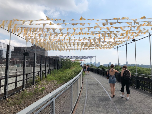 Rows and rows of pennants (like at a used car lot) flying across the High Lineflying