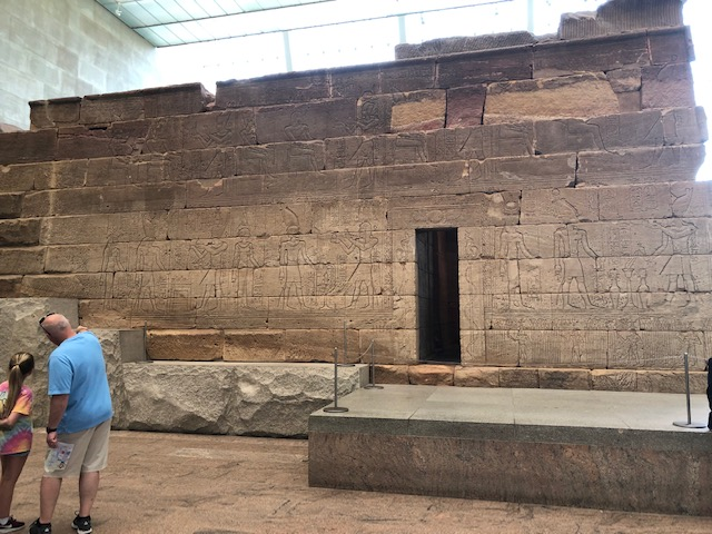 A closeup shot of the temple from the side, covered in hieroglyphics