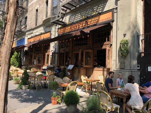 Outside Osteria Cotta, lots of tables on the sidewalk