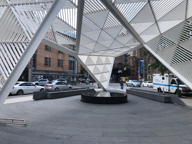 A white sculptured canopy at the NYC AIDS Memorial