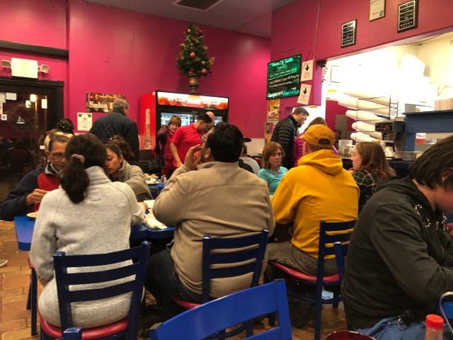 inside of the restaurant showing ever table full