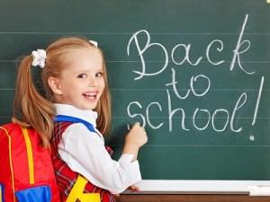 Schoolchild writting on blackboard.