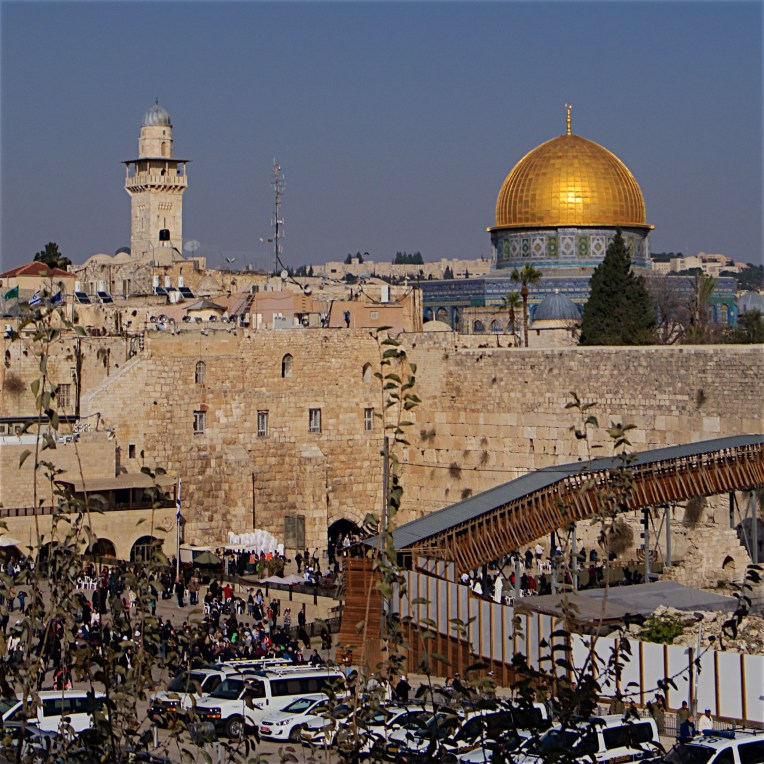 The Western Wall partialy obscured by the Mughrabi bridge and the Dome of the Rock