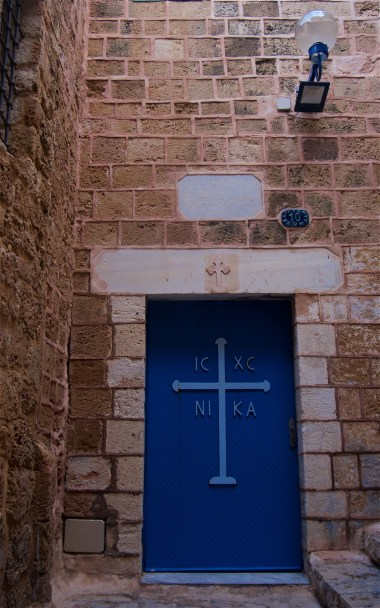 The entrance to a Greek Orthodox church in Jaffa; IC and XC are the first and last letters in the Greek words for Jesus and Christ. and NIKA means conquers or victorious, better known today as Nike