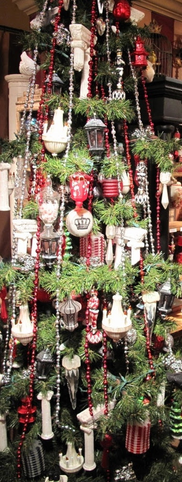 Sparkling black, red, white and silver ornaments give this narrow tree new life and pizazz!