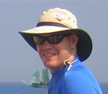 Steven Mentz; Steven Mentz wears a hat; behind him we see a ship