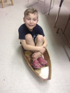 A Youngster is psyched to float his boat