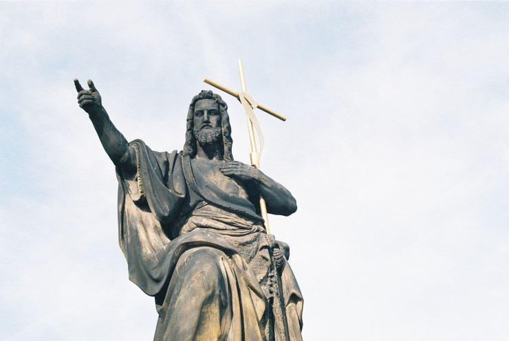 Analogue photo of a statue of Jesus on the Charles Bridge Prague