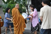 If you get out early enough you'll frequently see people giving food offerings or alms. Thailand is predominately Buddhist. No they're not giving away the baby.
