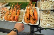 These grilled giant prawns are amazing. They're the size of my hand!