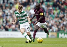 2CC9D1F300000578-3250097-James_Forrest_looks_to_release_a_team_mate_during_the_first_half-a-45_1443283639114