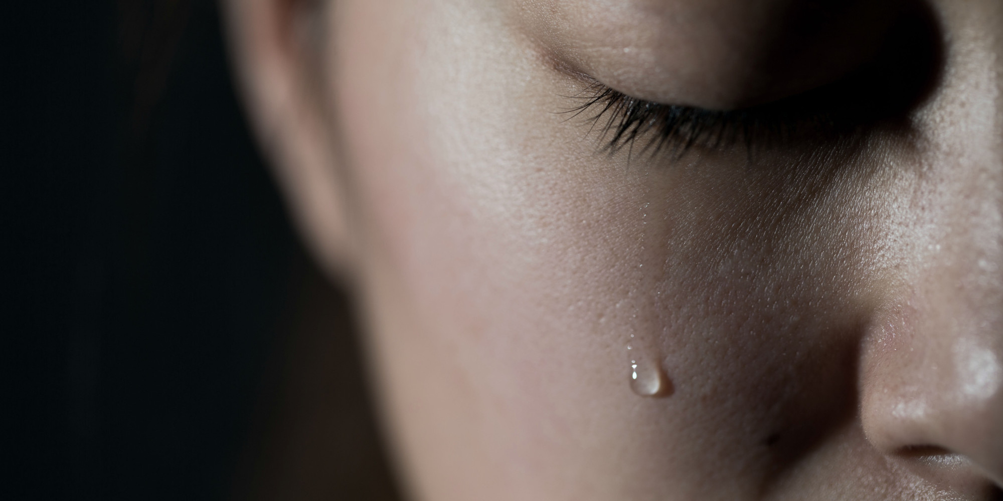 A sad little girl, a broken world, a tear.