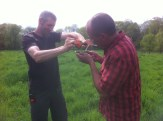 "Eric and Abe use the ""Vermont garlic press"" to squeeze some liquid from a grass sample onto the refractometer."