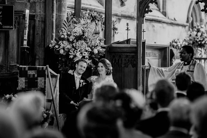 black and white photo of the couple in the church