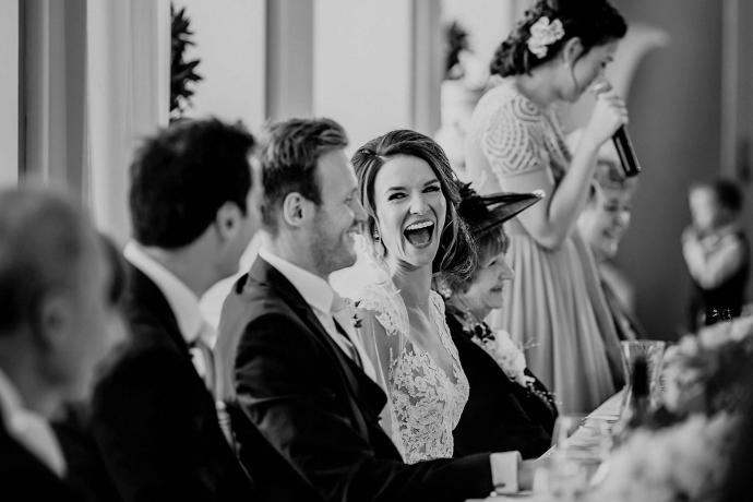 bride laughing in the wedding breakfast