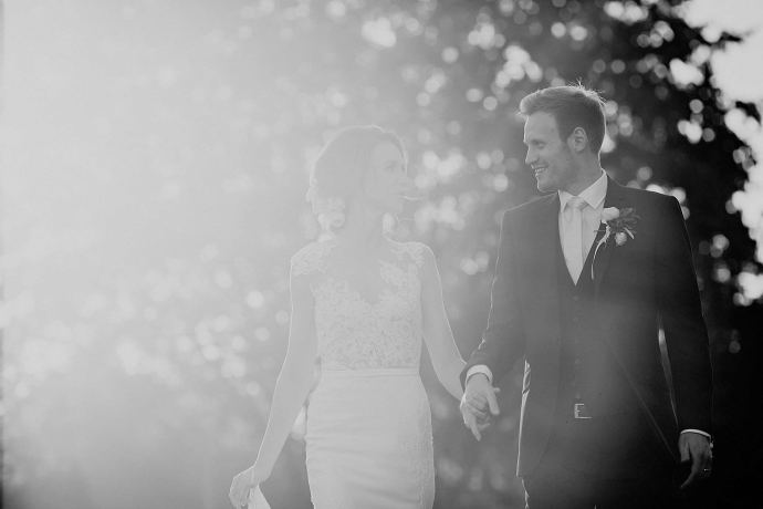 lens flare with bride and groom