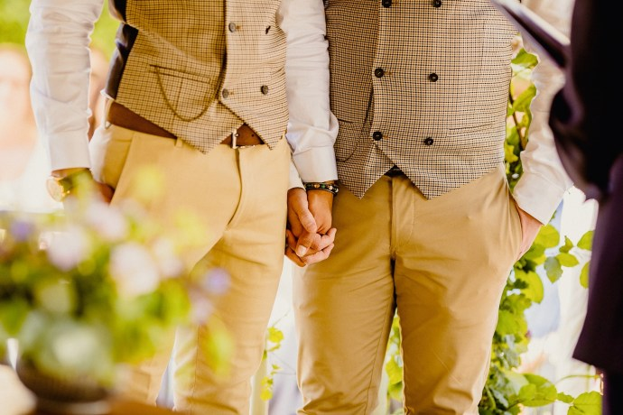 two grooms in suits