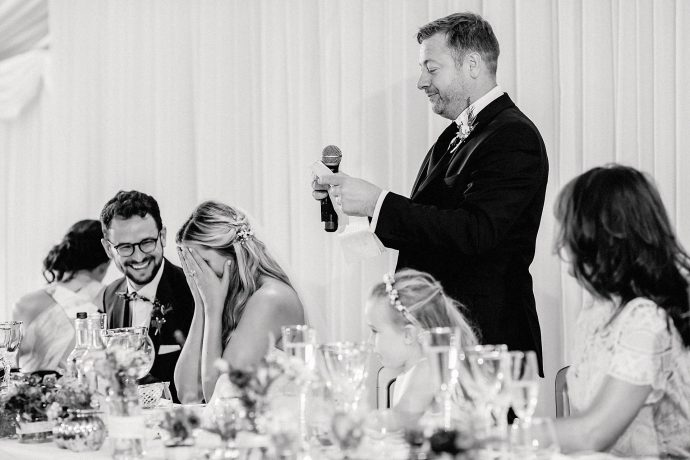 father of the bride speech, bride with head in hands, black and white image