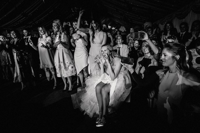 bride cheering on the groom