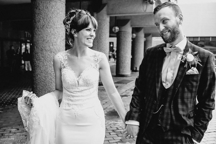 black and white photo, walking, bride and groom