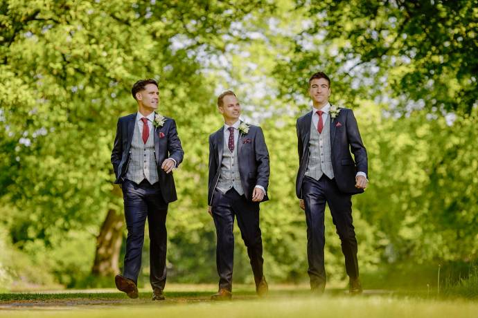 groomsmen arriving at the venue, walking, suits, summery photo