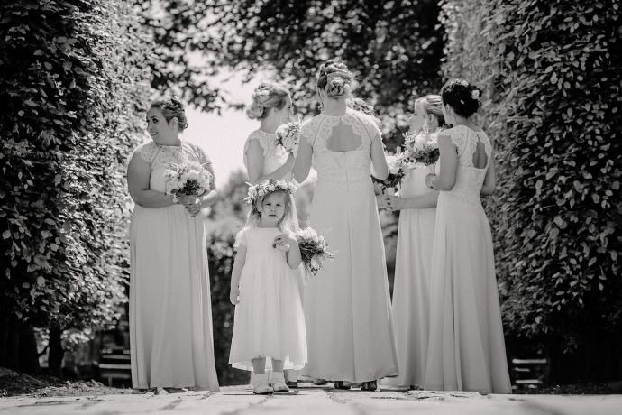 image of the bridesmaids and flower girl in black and white