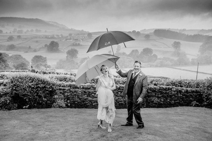 bride and father ofg the bride, umbrellas, yorkshire