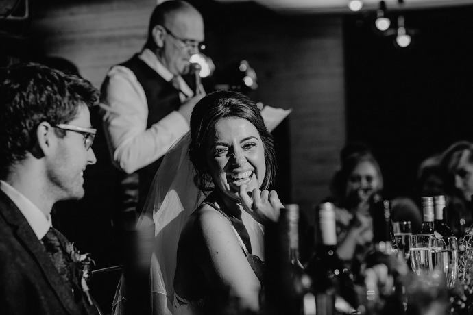 speeches, toasts during the wedding breakfast, bride laughing