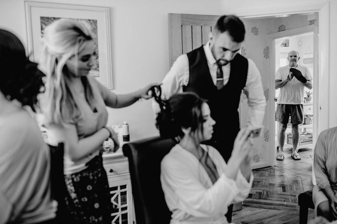 bride getting ready, dad polishing shoes in the kitchen
