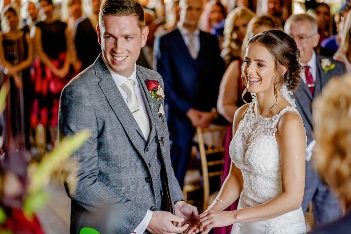 bride and groom smiling during wedding ceremony at the Hillbark, wirral
