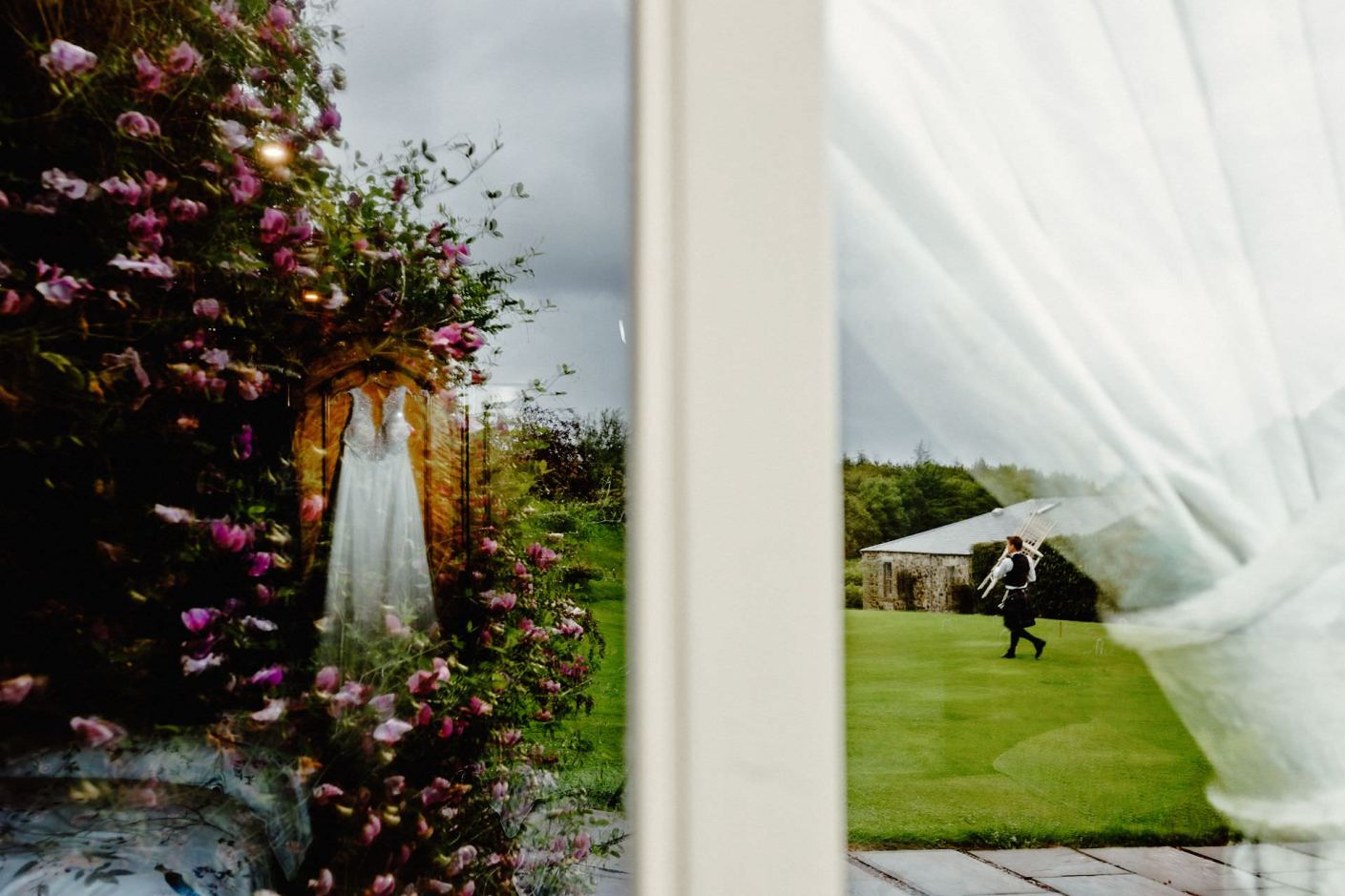 kilrie granary wedding photographer, wedding dress hanging on the wardrobe and reflection in the window