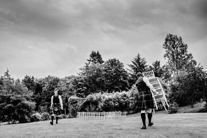 carrying chairs for the humanist ceremony in the garden