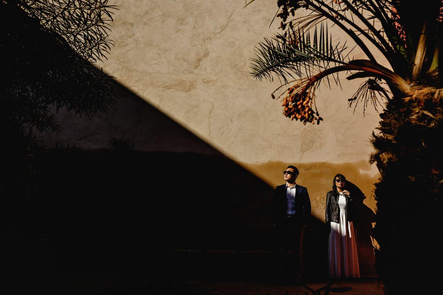 harsh light bride and groom in sunglasses