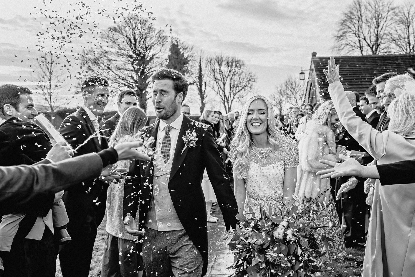 confetti throwing outside the church, documentary wedding photography
