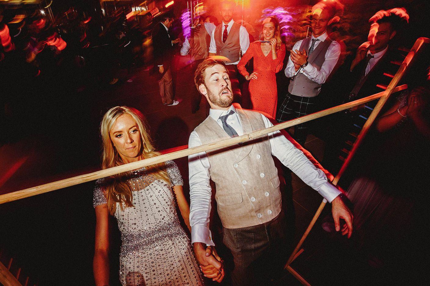 bride and groom limbo dancing