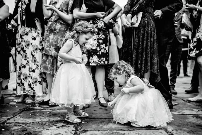 flower girls picking up confetti