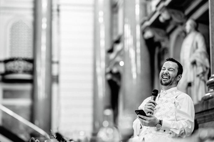 groom laughing during toasts