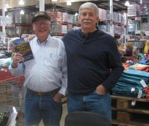 Retired game warden Gil Berg at a Costco book signing with author Steven T. Callan