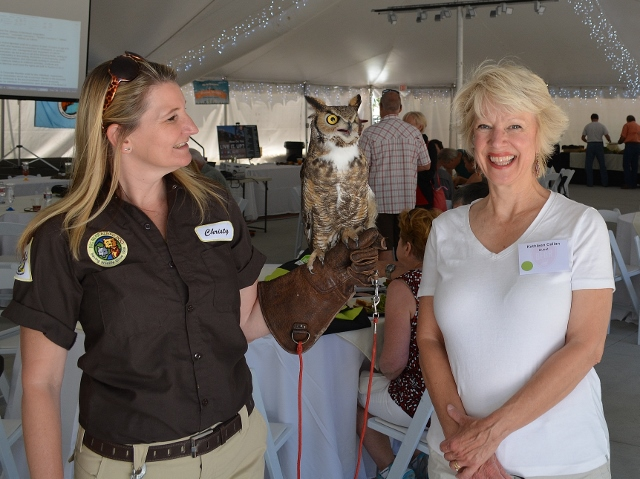 Christy McGiveron and Kathy Callan with Cowboy the great horned owl from the Big Bear Alpine Zoo