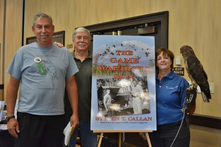 Author Steven T. Callan and friends at a book signing for The Game Warden's Son at the Pacific Flyway Decoy Association Festival