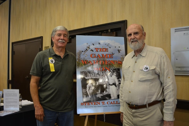 Author Steven T. Callan and friend at a book signing for The Game Warden's Son at the Pacific Flyway Decoy Association Wildfowl Art Festival