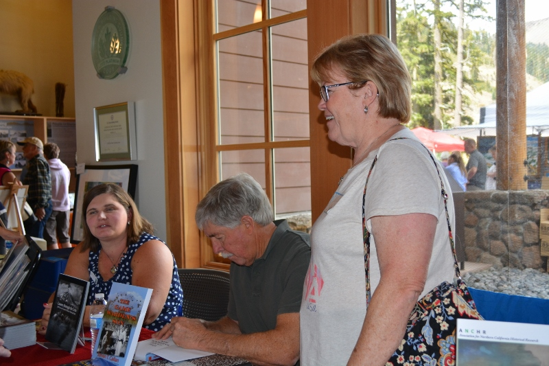 Authors Melanie Allen, Steven T. Callan, and Friend at Book Signing during Art and Wine Festival at Lassen Volcanic National Park