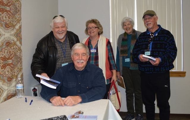 Author Steven T. Callan signs copies of his book The Game Warden's Son for members of Redding Writers Forum.