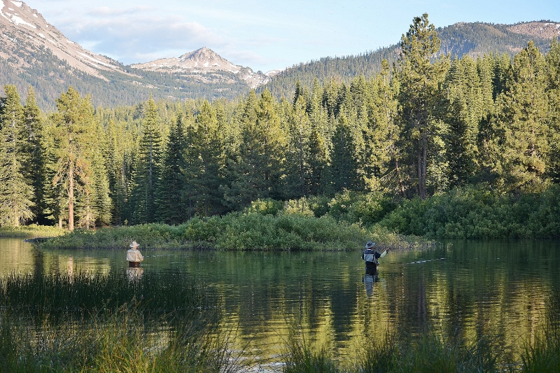 National parks provide recreation as well as inspiration: fly fishers at Manzanita Lake in Lassen Volcanic National Park. Photo by Kathy Callan.